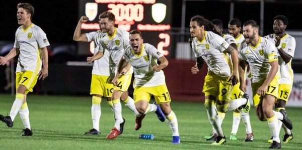 New Mexico United celebrates their penalty kick victory over the Denver Rapids MLS team