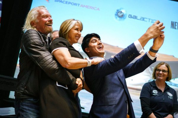Sir Richard Branson, Gov. Michelle Lujan Grisham, and Kevin Prieto celebrate Virgin Galactic's move to New Mexico